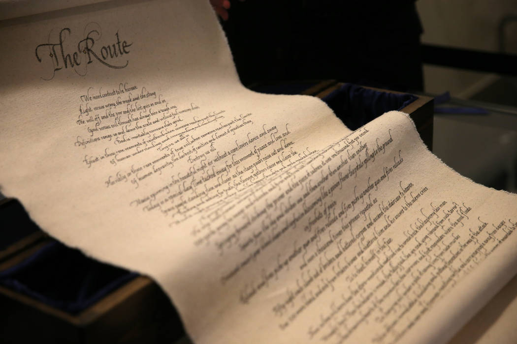 """""""The Route"""" poem scroll is unveiled at Metropolitan Police Department headquarters in Las Vegas Thursday, Oct. 25, 2018. The poem, written by police Lt. Harry Fagel in response to the 1 October sh ..."""