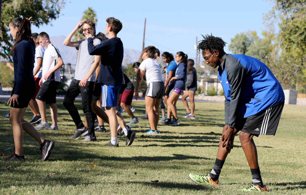 Valley High School cross country runner Christian Franklin, right, warms up for practice with his teammates at Justice Myron E. Leavitt Family Park in Las Vegas Wednesday, Oct. 24, 2018. K.M. Cann ...