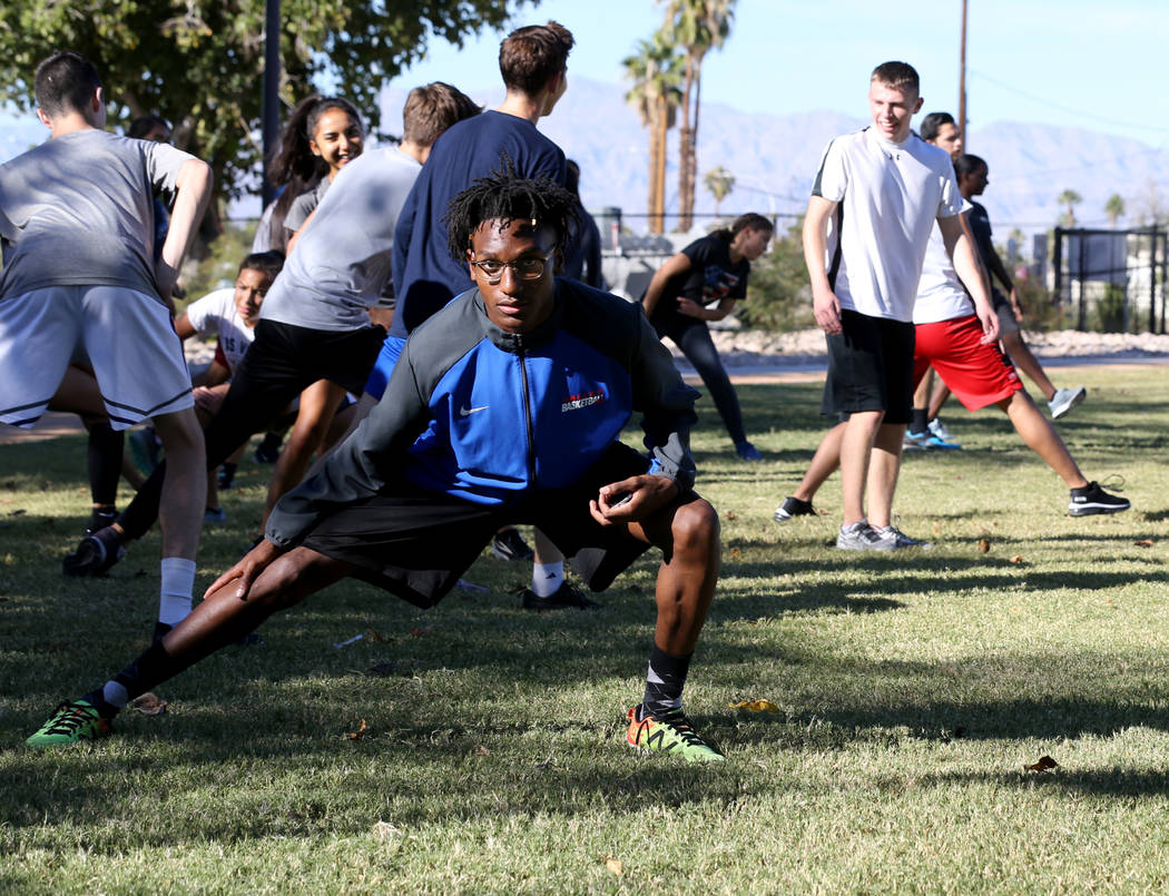 Valley High School cross country runner Christian Franklin, foreground, warms up for practice with his teammates at Justice Myron E. Leavitt Family Park in Las Vegas Wednesday, Oct. 24, 2018. K.M. ...