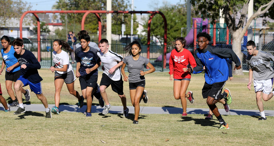 Valley High School cross country runner Christian Franklin, second from right, warms up for practice with his teammates at Justice Myron E. Leavitt Family Park in Las Vegas Wednesday, Oct. 24, 201 ...