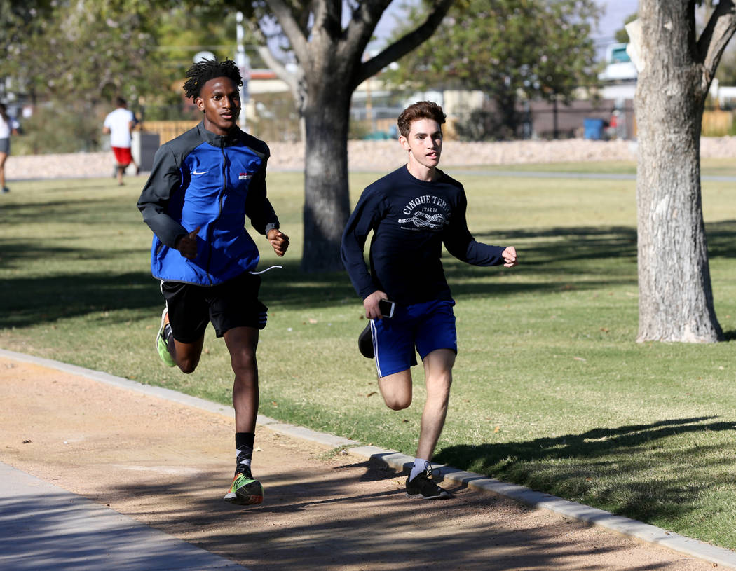 Valley High School cross country runner Christian Franklin, left, practices with teammate Donovan Jones at Justice Myron E. Leavitt Family Park in Las Vegas Wednesday, Oct. 24, 2018. K.M. Cannon L ...