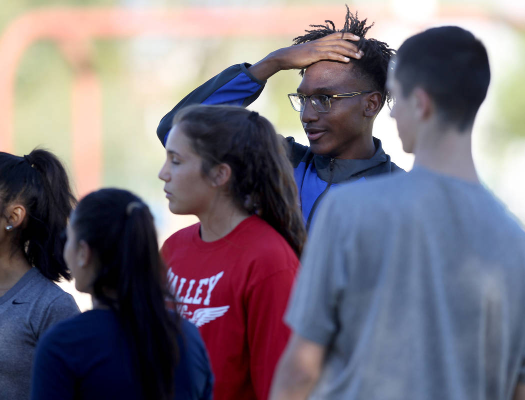 Valley High School cross country runner Christian Franklin, second from right, prepares for practice with his teammates at Justice Myron E. Leavitt Family Park in Las Vegas Wednesday, Oct. 24, 201 ...