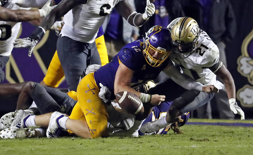 East Carolina's Holton Ahlers (12) is stopped from recovering his fumble by Central Florida's Rashard Causey (21) during the second half of an NCAA college football game in Greenville, N.C., Satur ...