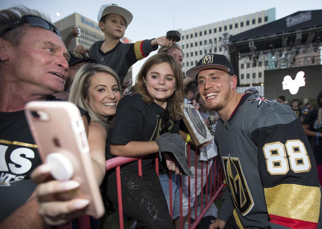 Vegas Golden Knights defenseman Nate Schmidt (88) poses with fans during a Vegas Golden Knights fan fest at the Downtown Las Vegas Events Center on Wednesday, Sept. 19, 2018. Richard Brian Las Veg ...