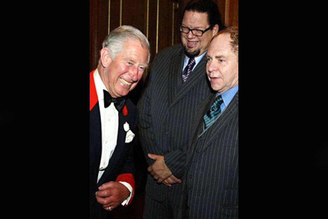 Penn & Teller are shown with Prince Charles during the prince's 70th birthday party at the London Palladium on Monday, Oct. 22, 2018. (Glenn Alai)