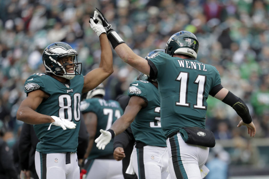 FILE - In this Sunday, Oct. 21, 2018, file photo, Philadelphia Eagles quarterback Carson Wentz (11) and wide receiver Jordan Matthews (80) celebrate Wentz's touchdown pass to wide receiver Alshon ...