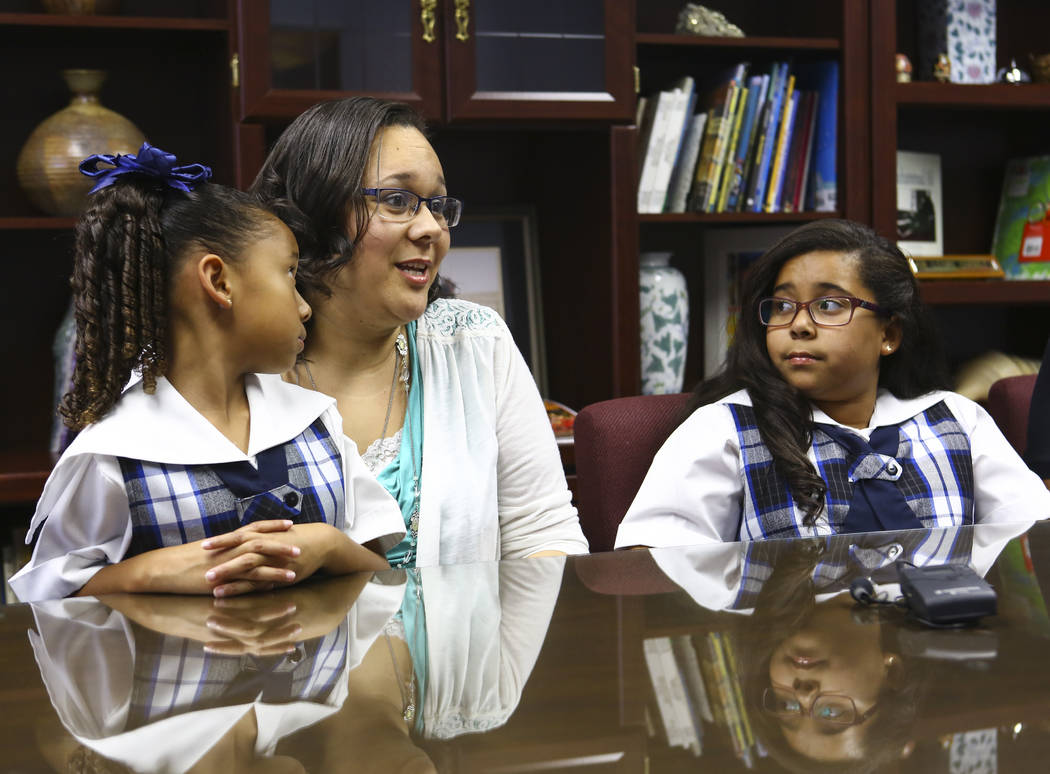Alina Ruiz, center, talks about the scholarships her daughters Makayla, 7, left, and Aleissya, 10, received at The Meadows School in Las Vegas on Wednesday, Oct. 24, 2018. Chase Stevens Las Vegas ...