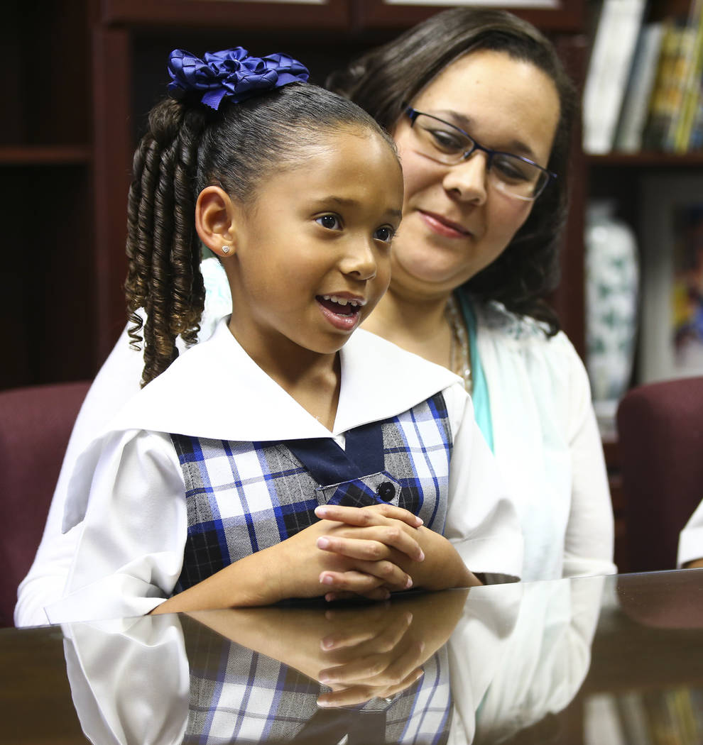 Seven-year-old Makayla Ruiz talks about her experiences at The Meadows School as her mother Alina Ruiz looks on in Las Vegas on Wednesday, Oct. 24, 2018. Chase Stevens Las Vegas Review-Journal @cs ...