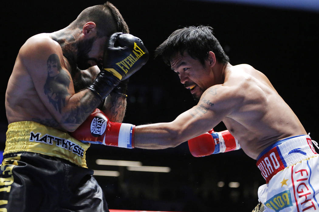 Manny Pacquiao, right, of the Philippines, lands a punch at Lucas Matthysse of Argentina during their WBA World welterweight title bout in Kuala Lumpur, Malaysia, Sunday, July 15, 2018. Pacquiao c ...