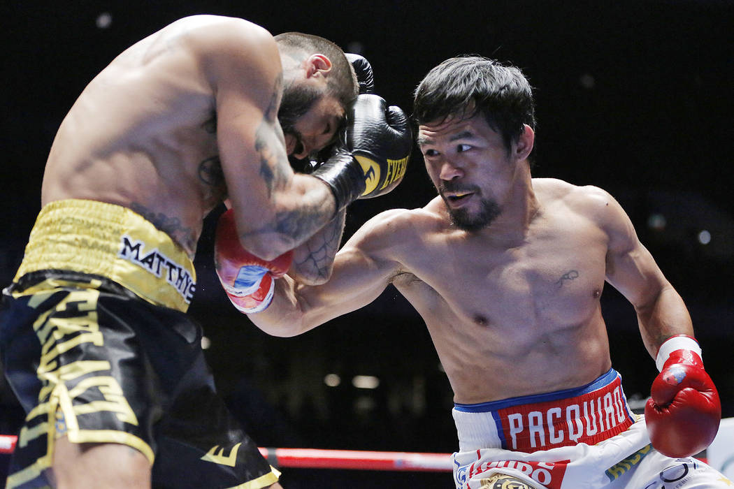 Manny Pacquiao of the Philippines, right, strikes Lucas Matthysse of Argentina during their WBA World welterweight title bout in Kuala Lumpur, Malaysia, Sunday, July 15, 2018. Pacquiao won the WBA ...
