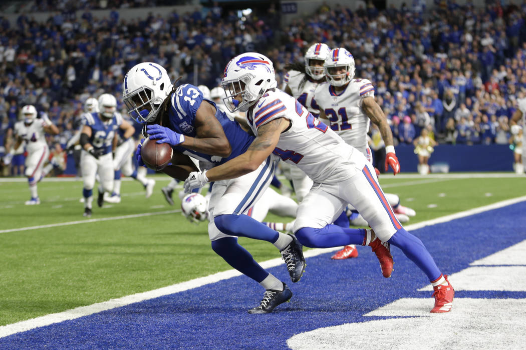 Indianapolis Colts wide receiver T.Y. Hilton (13) makes catch for a touchdown in front of Buffalo Bills cornerback Taron Johnson (24) during the second half of an NFL football game in Indianapolis ...