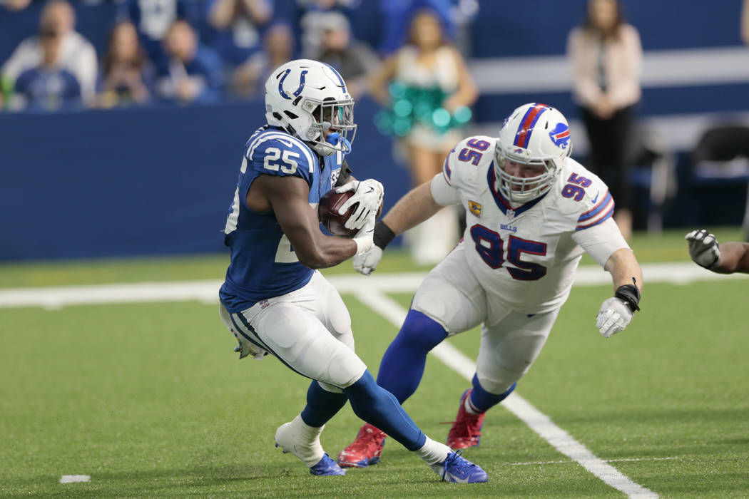 Indianapolis Colts running back Marlon Mack (25) cuts in front of Buffalo Bills defensive tackle Kyle Williams (95) during the second half of an NFL football game in Indianapolis, Sunday, Oct. 21, ...