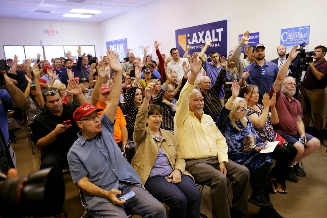 Supporters show that they have voted during a campaign event for Sen. Dean Heller, R-Nev., and 3rd Congressional District candidate Danny Tarkanian at the Nevada GOP Victory Office in Henderson Fr ...