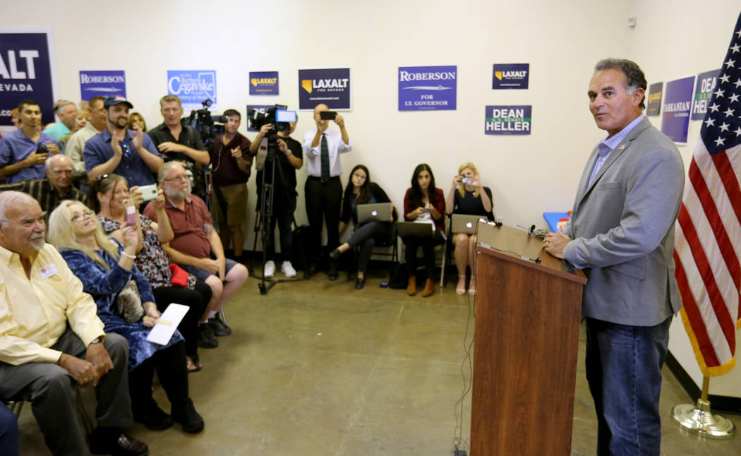 Supporters listen to 3rd Congressional District candidate Danny Tarkanian during a campaign event for Tarkanian and U.S. Sen. Dean Heller, R-Nev. at the Nevada GOP Victory Office in Henderson Frid ...