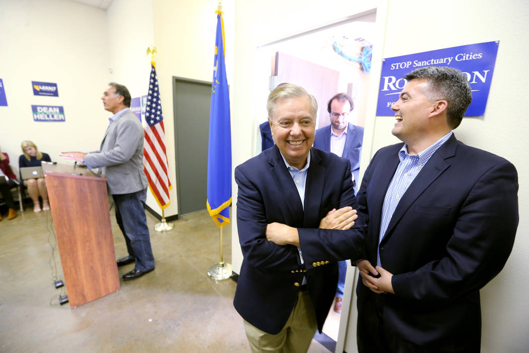 Sen. Lindsey Graham, R-S.C., second from right, and Sen. Cory Gardner, R-Colo., right, listen to 3rd Congressional District candidate Danny Tarkanian during an event for Tarkanian and Sen. Dean He ...