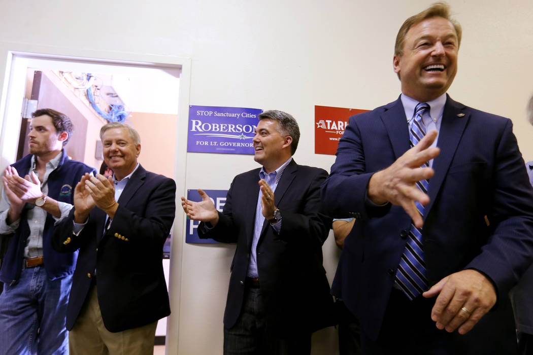 Sen. Dean Heller, R-Nev., right, greets a supporter as Sen. Cory Gardner, R-Colo., second from right, and Sen. Lindsey Graham, R-S.C., look on during a campaign event for Heller and 3rd Congressio ...