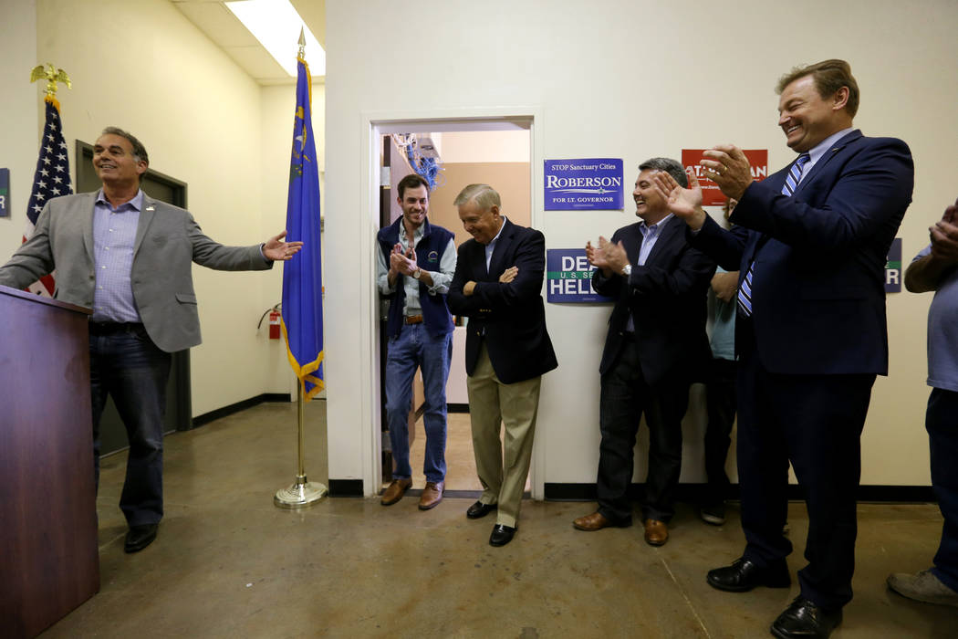 Sen. Dean Heller, R-Nev., right, and Sen. Cory Gardner, R-Colo., second from right, applaud Sen. Lindsey Graham, R-S.C., center as 3rd Congressional District candidate Danny Tarkanian speaks durin ...