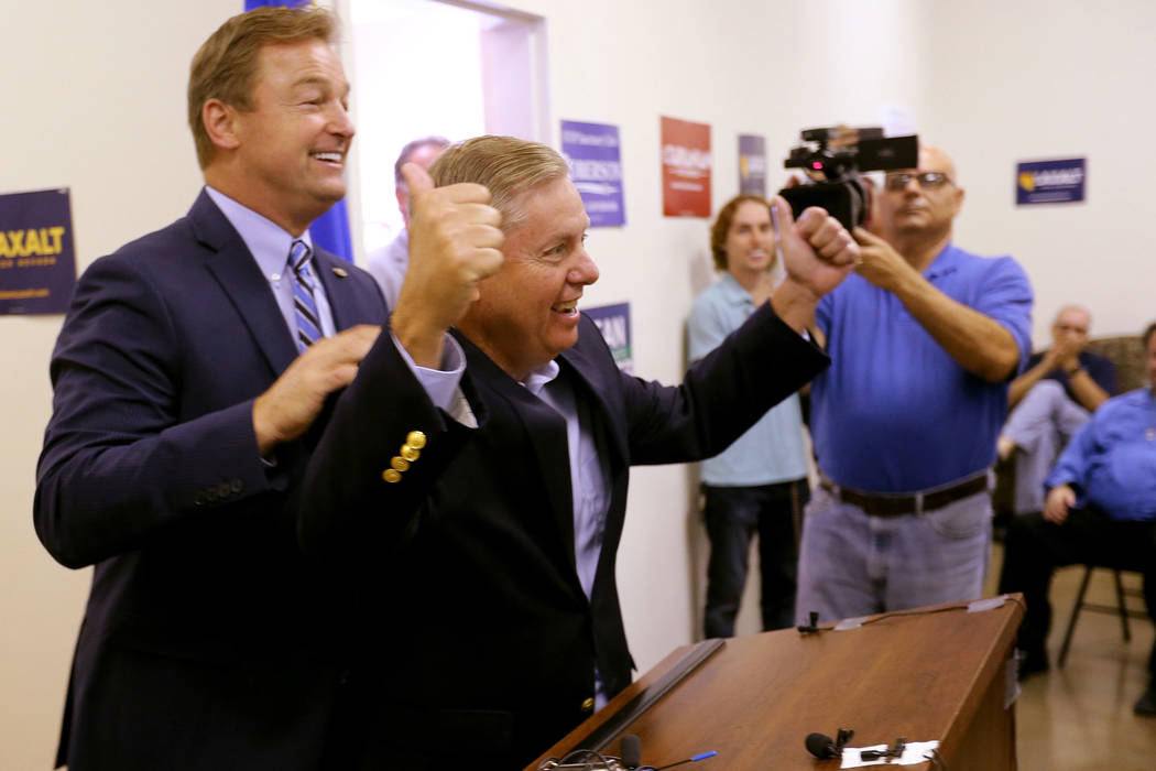 Sen. Dean Heller, R-Nev., left, greets Sen. Lindsey Graham, R-S.C., during a campaign event for Heller and 3rd Congressional District candidate Danny Tarkanian at the Nevada GOP Victory Office in ...