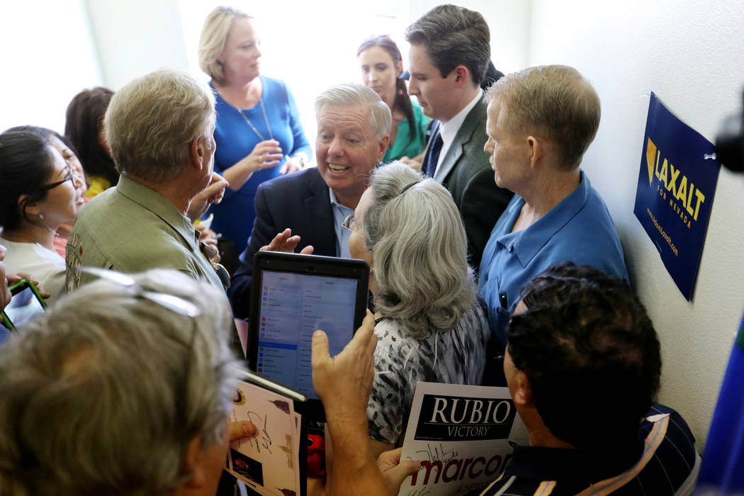 U.S. Sen. Lindsey Graham, R-S.C., center, during a campaign event for U.S. Sen. Dean Heller, R-Nev., and 3rd Congressional District candidate Danny Tarkanian at the Nevada GOP Victory Office in He ...