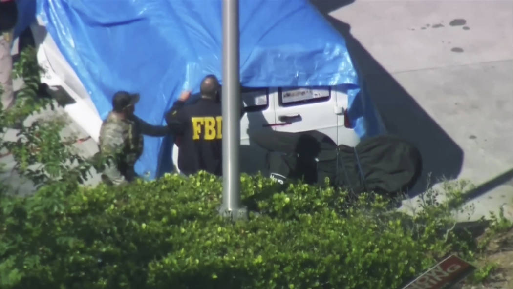 In this frame grab from video provided by WPLG-TV, FBI agents cover a van parked in Plantation, Fla., on Friday, Oct. 26, 2018, that federal agents and police officers have been examining in conne ...