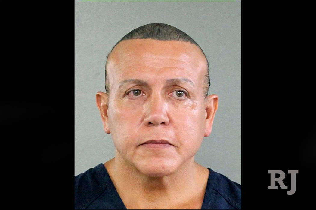 In this undated photo released by the Broward County Sheriff's office, Cesar Sayoc is seen in a booking photo, in Miami. Federal authorities took Sayoc, 56, of Aventura, Fla., into custody Friday ...