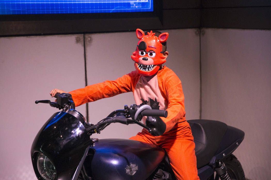 Las Vegas resident DeAngelo Mejia, 7, dressed in a Five Nights at Freddy's costume poses on a motorcycle display during a Trick-or-Treat event at the Marvel Avengers S.T.A.T.I.O.N. inside Treasure ...