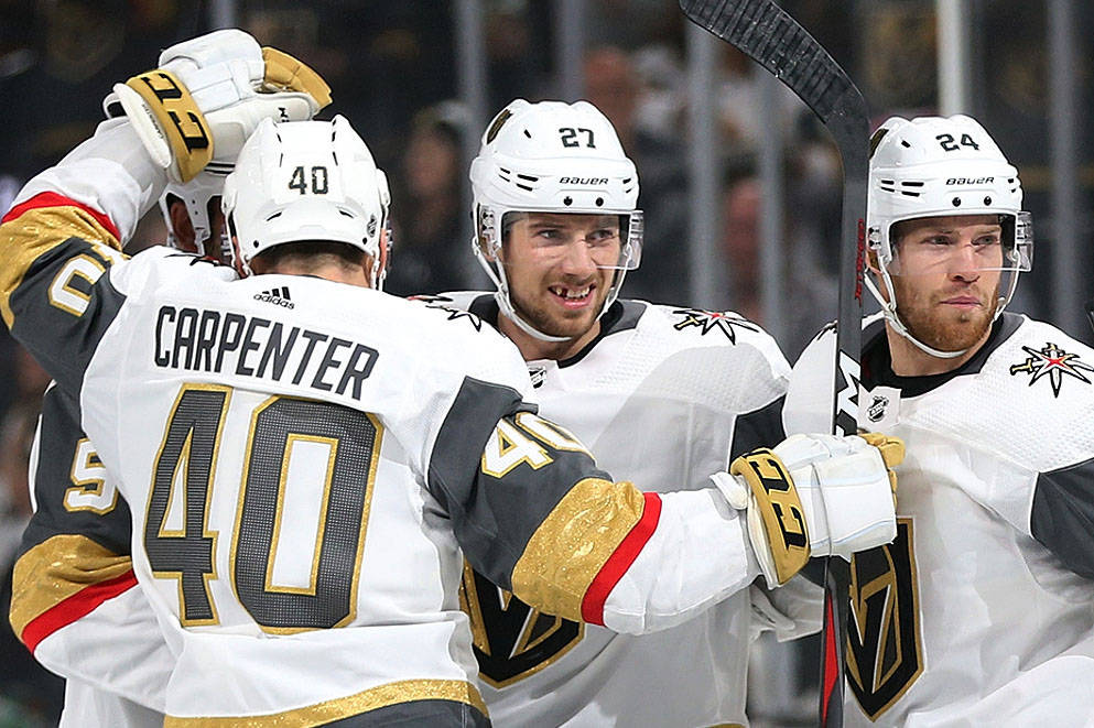 Vegas Golden Knights defenseman Shea Theodore (27) celebrates a score with his team during the first period of an NHL game at T-Mobile Arena in Las Vegas, Friday, Oct. 26, 2018. Erik Verduzco Las ...