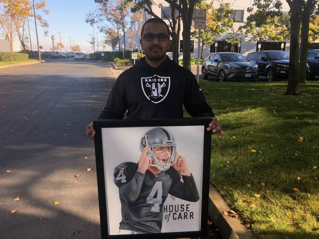 Raiders fan Mandeep Bajwa holds a pencil sketch he made in 2015 and presented to quarterback Derek Carr at team headquarters on Oct. 25, 2018, in Alameda, Calif. (Michael Gehlken)