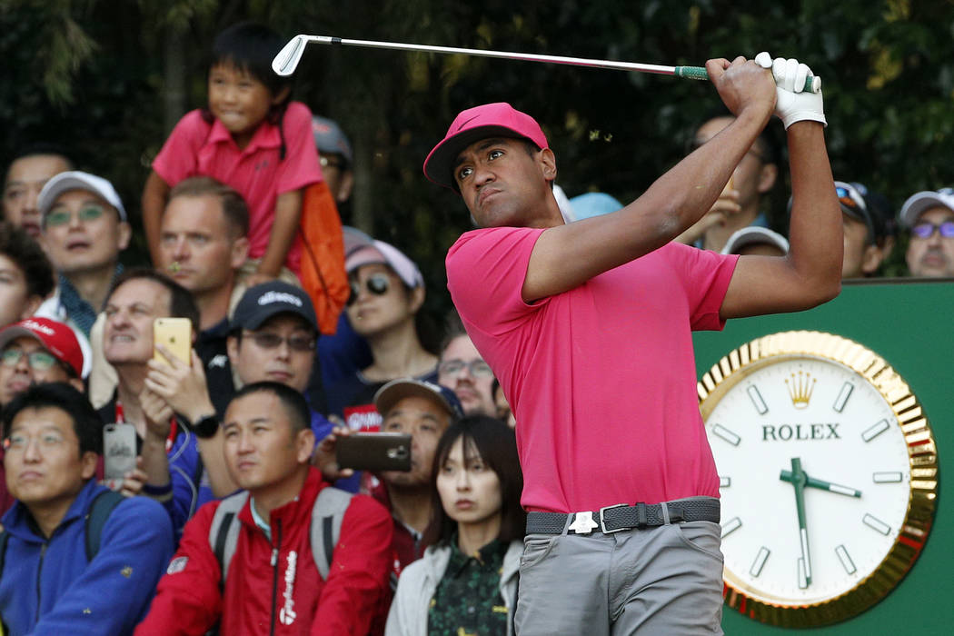 Tony Finau of the United States tees off during round three of the HSBC Champions golf tournament held at the Sheshan International Golf Club in Shanghai, Saturday, Oct. 27, 2018. (AP Photo/Ng Han ...