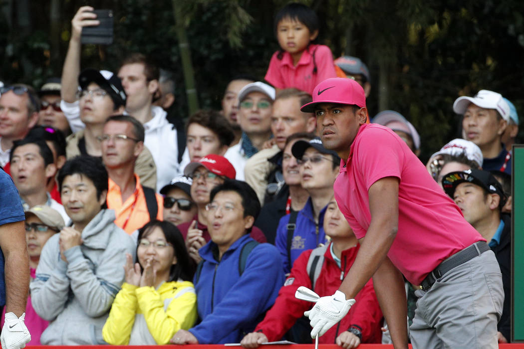 Tony Finau of the United States follows his shot during round three of the HSBC Champions golf tournament held at the Sheshan International Golf Club in Shanghai, Saturday, Oct. 27, 2018. (AP Phot ...
