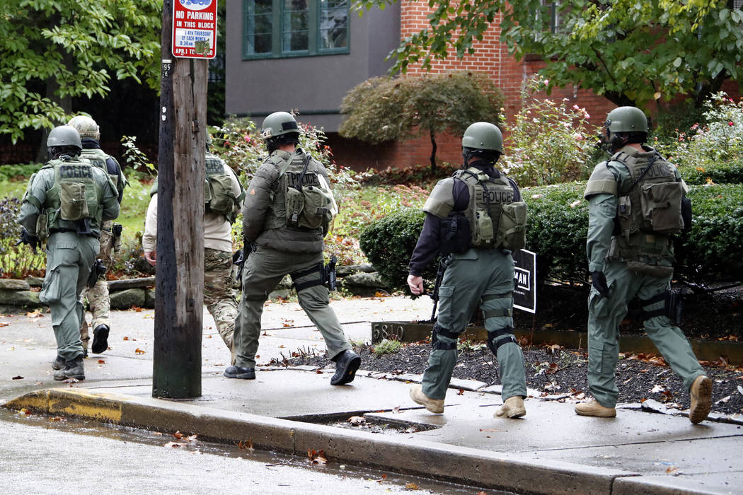 A SWAT team arrives at the Tree of Life Synagogue inPittsburgh, Pa. where a shooter opened fire injuring multiple people, Saturday, Oct. 27, 2018. (AP Photo/Gene J. Puskar)