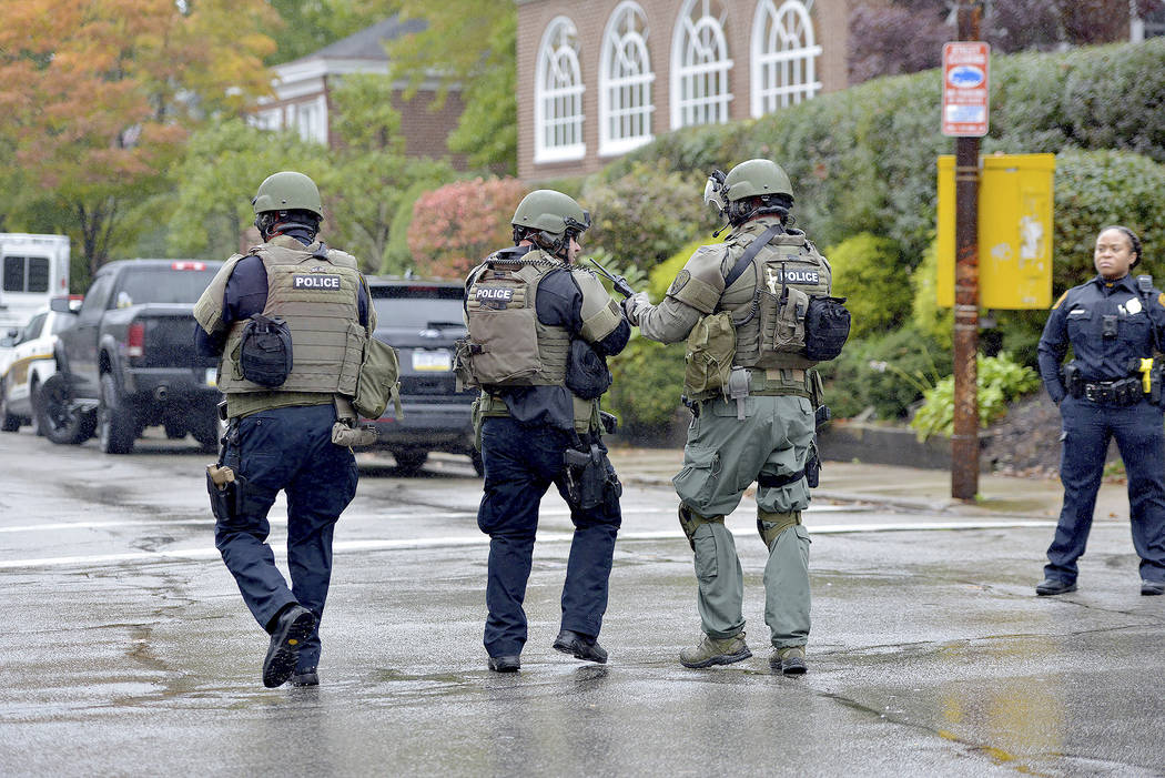 Polikce respond to an active shooter situation at the Tree of Life synagogue on Wildins Avenue in the Squirrel Hill neighborhood of Pittsburgh, Pa., on Saturday, October 27, 2018. (Pam Panchak/Pit ...