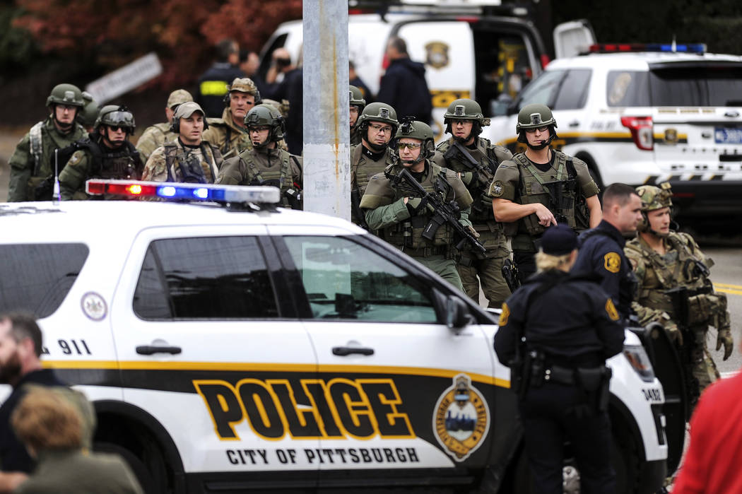Law enforcement officers secure the scene where multiple people were shot, Saturday, Oct. 27, 2018, at the Tree of Life Congregation in Pittsburgh's Squirrel Hill neighborhood. (Alexandra Wimley/P ...