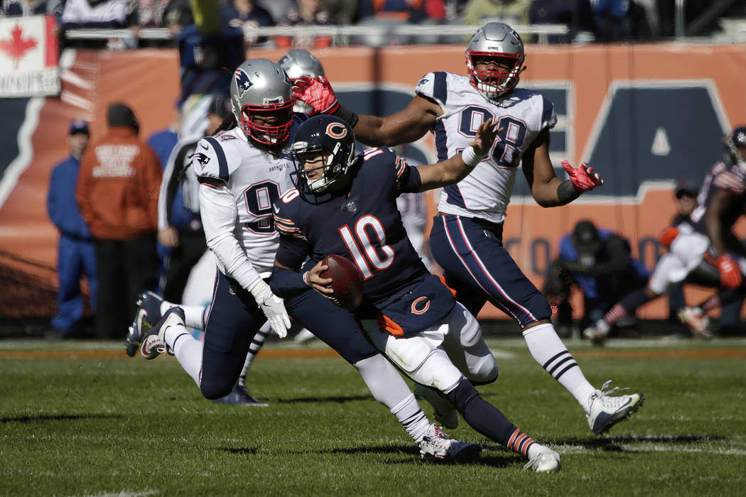 Chicago Bears quarterback Mitchell Trubisky (10) scrambles to the end zone for a touchdown during the first half of an NFL football game against the New England Patriots Sunday, Oct. 21, 2018, in ...