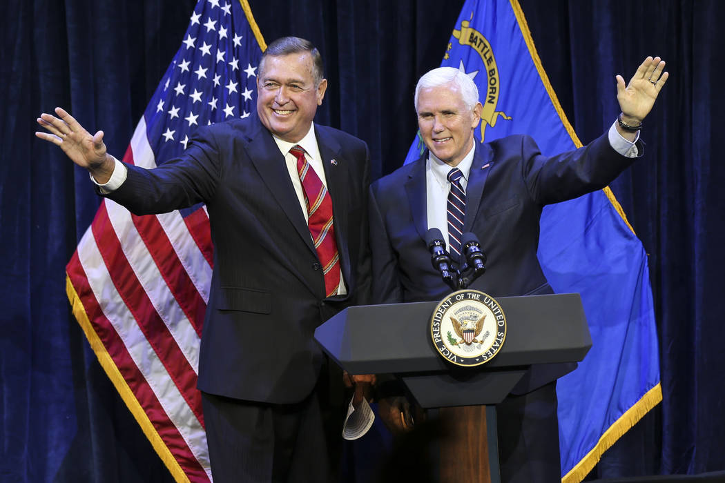 Vice President Mike Pence, right, joins Cresent Hardy, Republican candidate for the 4th Congressional District, during a campaign event at the Sands Showroom in The Venetian in Las Vegas on Saturd ...