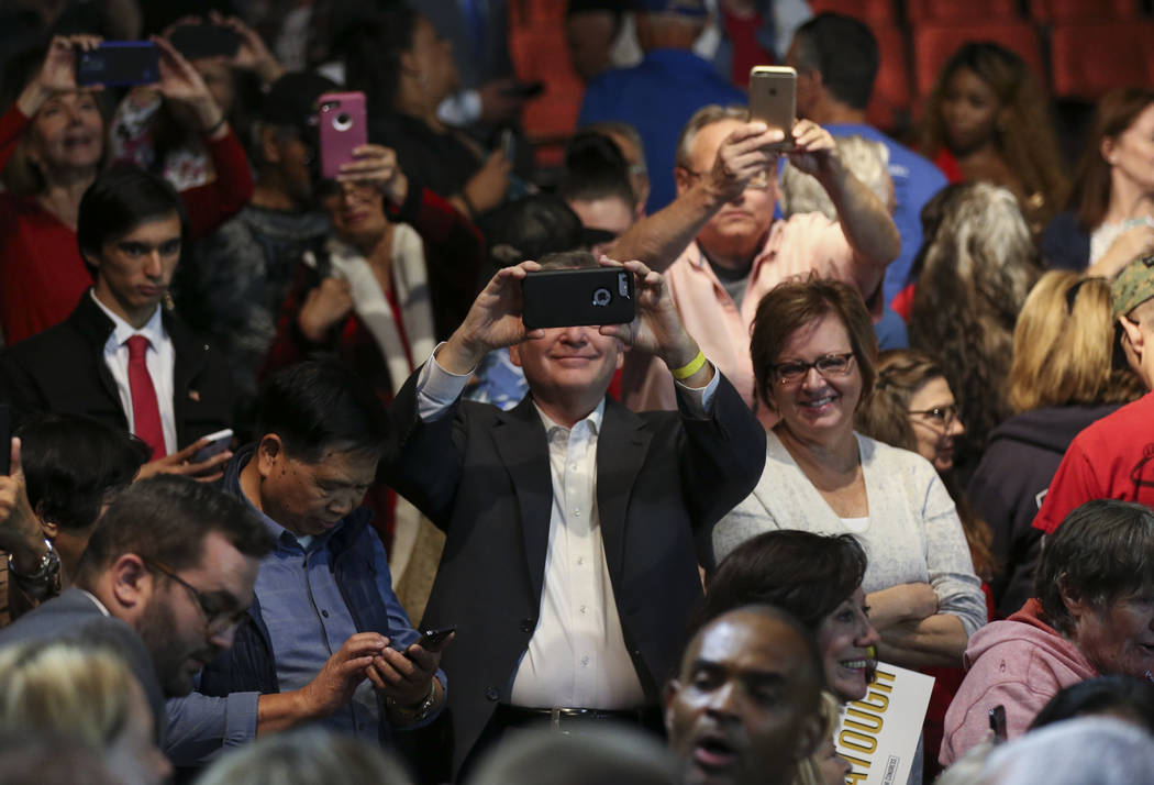 Attendees record Vice President Mike Pence as he visits with supporters during a campaign event for Cresent Hardy, Republican candidate for the 4th Congressional District at the Sands Showroom in ...