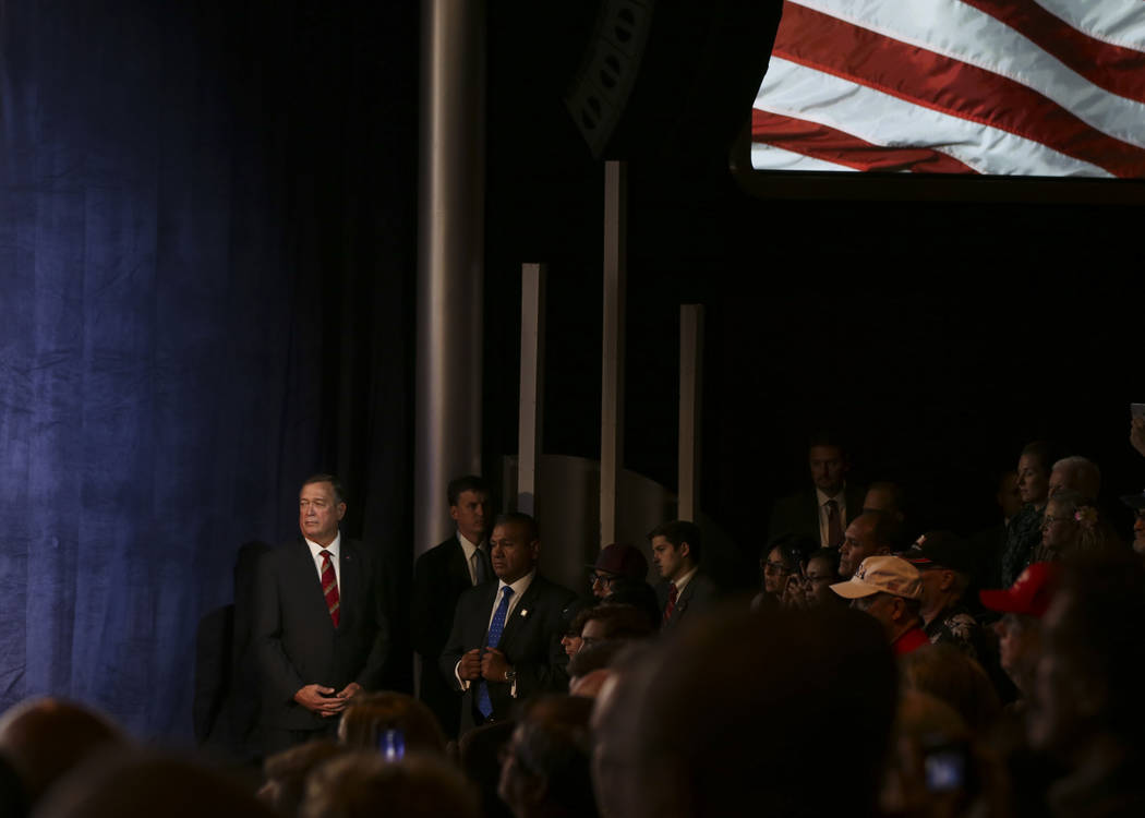 Cresent Hardy, Republican candidate for the 4th Congressional District, left, listens as Vice President Mike Pence speaks during a campaign event at the Sands Showroom in The Venetian in Las Vegas ...