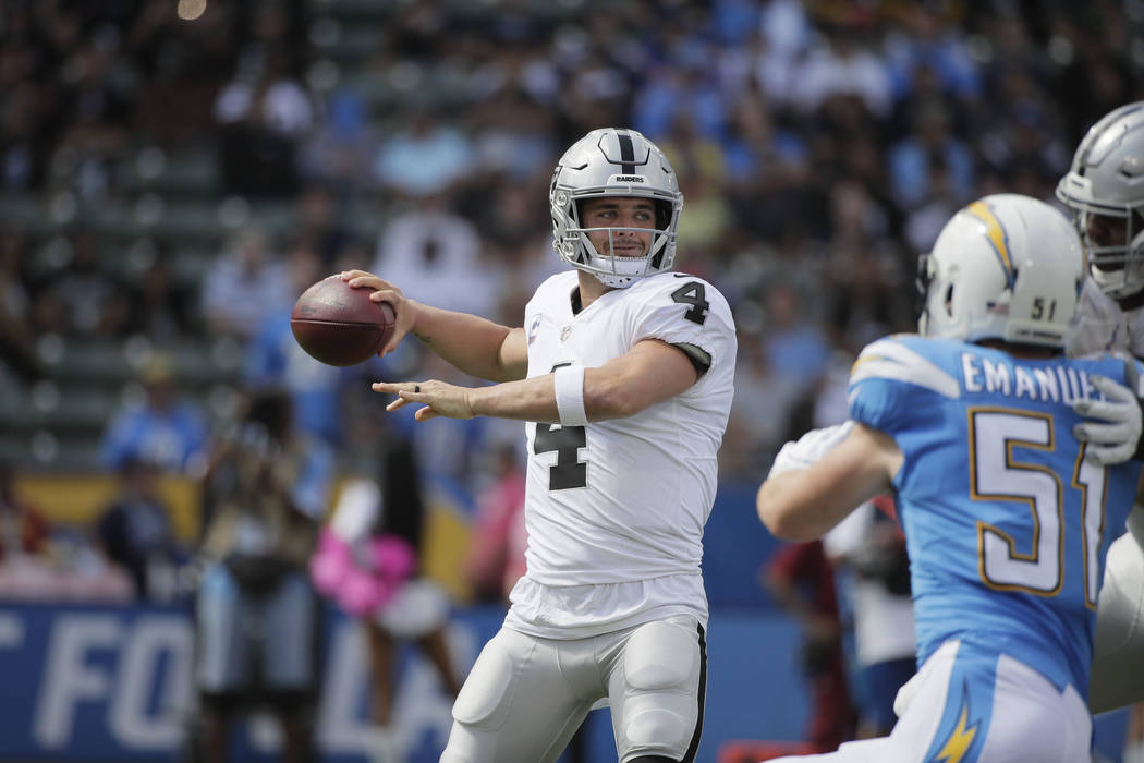 Oakland Raiders quarterback Derek Carr looks to throw a pass during an NFL football game against the Los Angeles Chargers Sunday, Oct. 7, 2018, in Carson, Calif. (AP Photo/Jae C. Hong)
