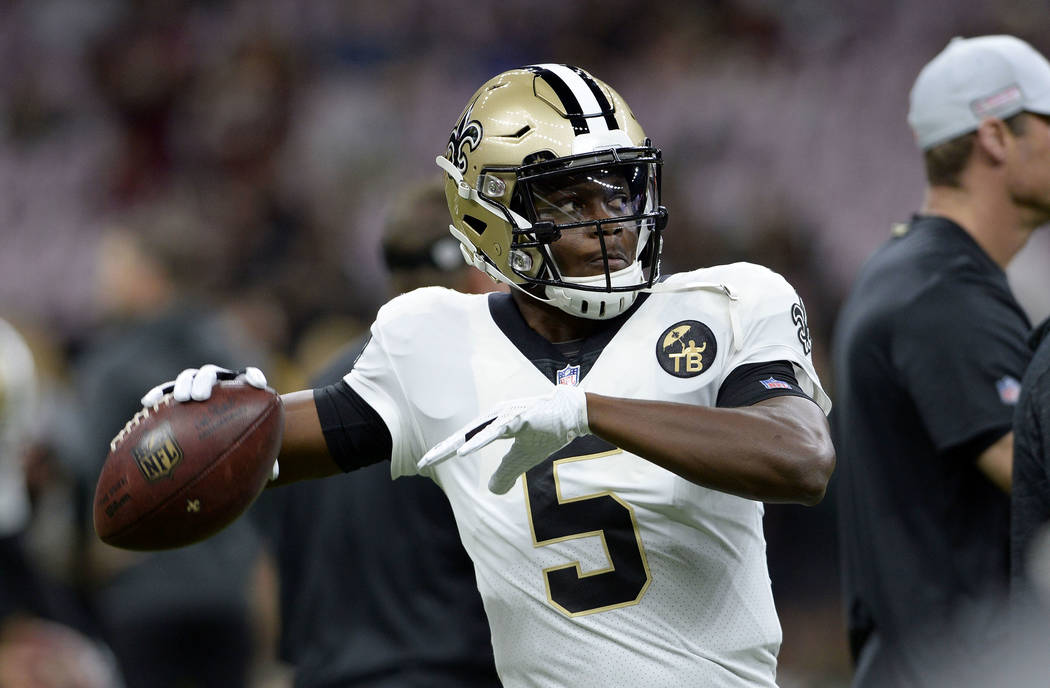 New Orleans Saints quarterback Teddy Bridgewater (5) warms up before an NFL football game against the Washington Redskins in New Orleans, Monday, Oct. 8, 2018. (AP Photo/Bill Feig)
