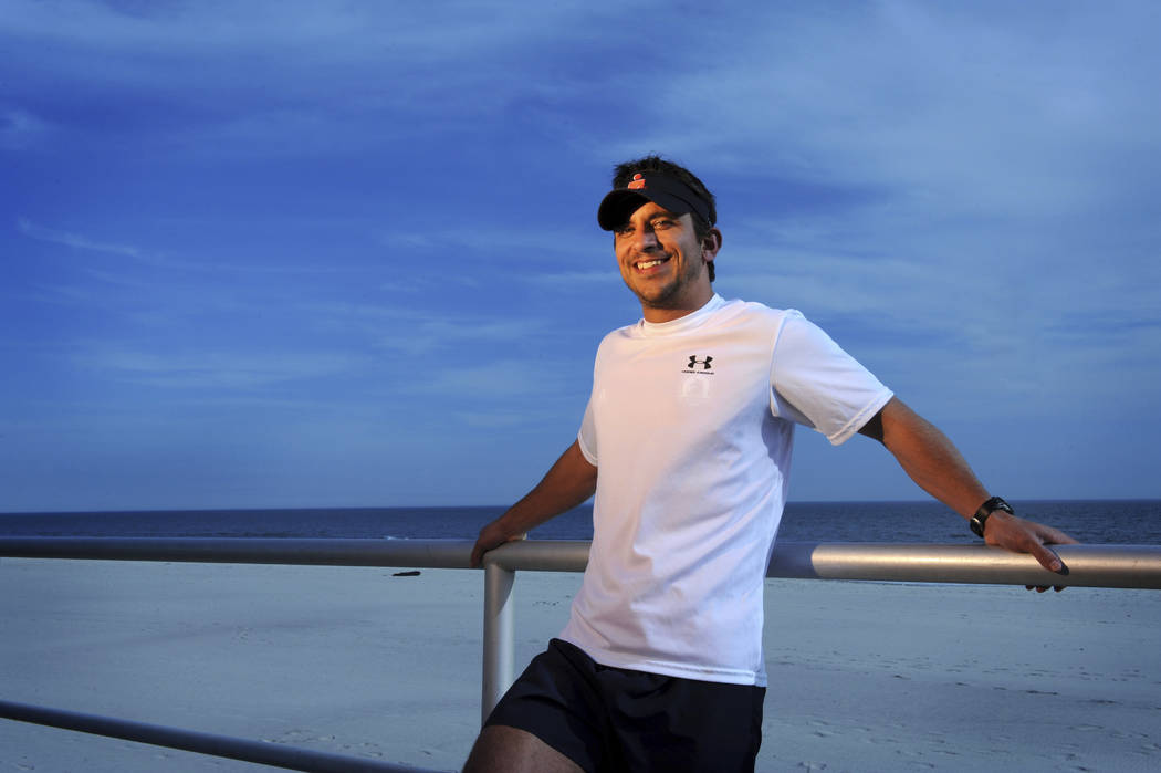 FILE - In this April 5, 2009, file photo, Patrick Harten, a New York air traffic controller, poses for a portrait while working out in preparation for running the Boston Marathon, in Long Beach, N ...