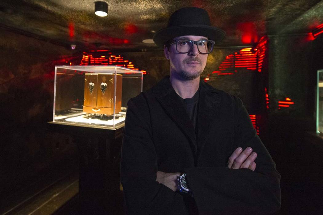 Ghost hunter Zak Bagans poses with his Dybbuk Box, known as the world's most haunted object, at Zak Bagans' The Haunted Museum located at 600 E. Charleston Blvd. in downtown Las Vegas on Monday, O ...
