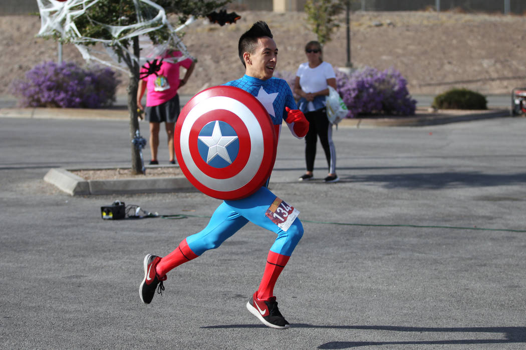 Jeremiah Smith, 23, sprints to the finish line during the Halloween 5K run at Fiesta Henderson hotel-casino in Las Vegas, Saturday, Oct. 27, 2018. Erik Verduzco Las Vegas Review-Journal @Erik_Verduzco