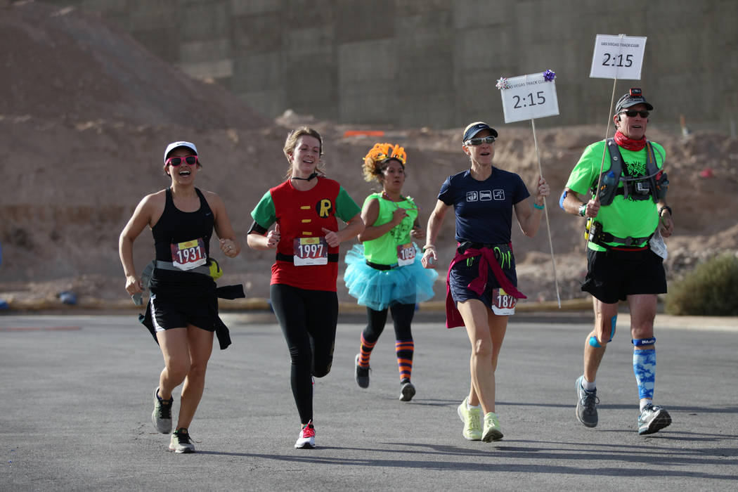 Runners sprint to the finish line during the Halloween half marathon and 5K runs at Fiesta Henderson hotel-casino in Las Vegas, Saturday, Oct. 27, 2018. Erik Verduzco Las Vegas Review-Journal @Eri ...