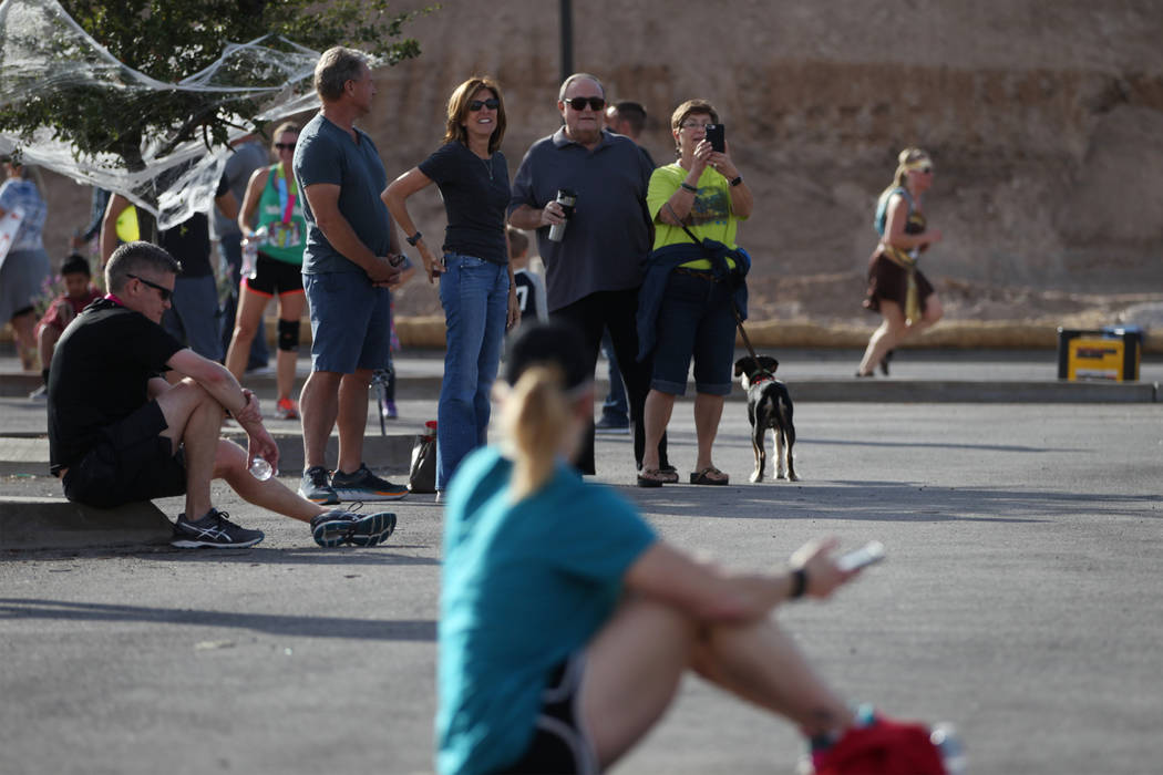 People watch as runners sprint to the finish during the Halloween half marathon and 5K runs at Fiesta Henderson hotel-casino in Las Vegas, Saturday, Oct. 27, 2018. Erik Verduzco Las Vegas Review-J ...