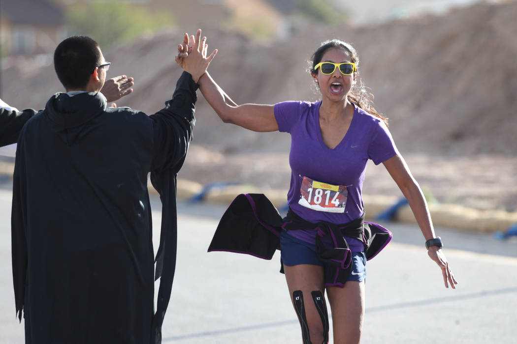 Melissa Hillmen of Las Vegas runs to the finish line of the Halloween half marathon run at Fiesta Henderson hotel-casino in Las Vegas, Saturday, Oct. 27, 2018. Erik Verduzco Las Vegas Review-Journ ...