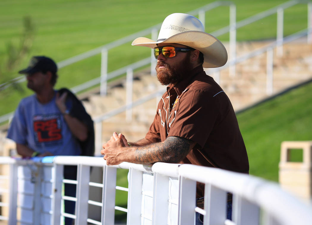Frank Torres, 35, watches a performer at the Country 58 Benefit Concert at the Henderson Pavilion on Saturday, Oct. 27, 2018. The Country 58 concert was put on to help those affected by the Route ...