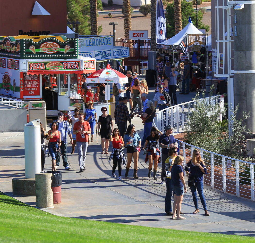 Festivalgoers walk around to the stage during the Country 58 Benefit Concert at the Henderson Pavilion on Saturday, Oct. 27, 2018. The Country 58 concert was put on to help those affected by the R ...