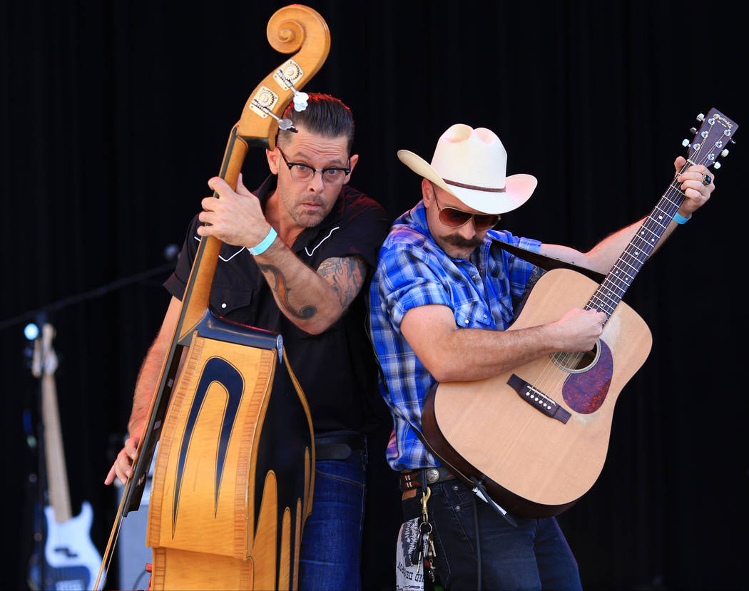 Chris Davis, left, plays upright bass and Erik Alesi, right, plays acoustic guitar with The Rhyolite Sound at the Country 58 Benefit Concert at the Henderson Pavilion on Saturday, Oct. 27, 2018. T ...