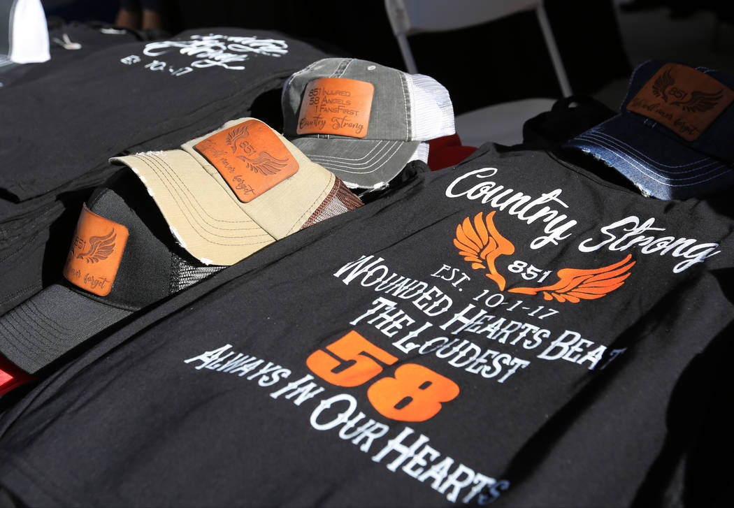 T-shirts and hats to memorialize the Route 91 shooting for sale at the Country 58 Benefit Concert at the Henderson Pavilion on Saturday, Oct. 27, 2018. The Country 58 concert was put on to help th ...