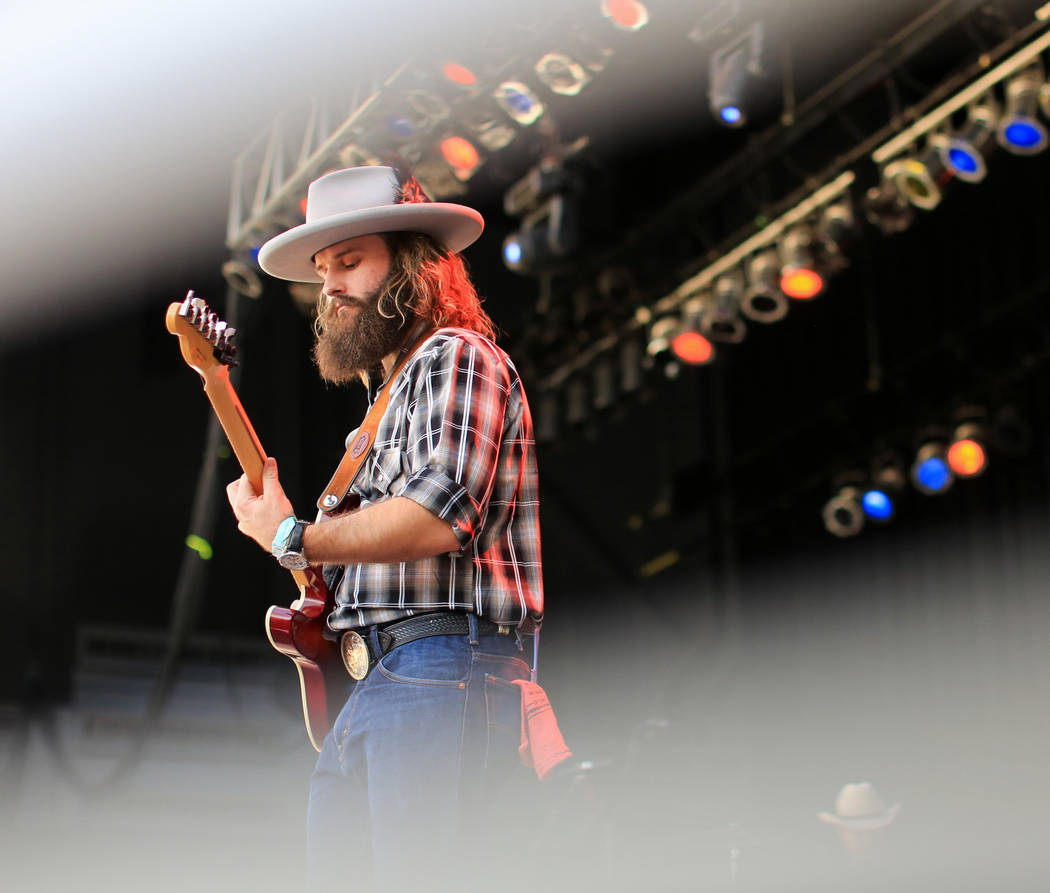 Chase Nutter plays lead guitar with The Rhyolite Sound at the Country 58 Benefit Concert, to help those affected by the Route 91 shooting, at the Henderson Pavilion on Saturday, Oct. 27, 2018. The ...